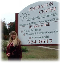 Dr. Hall in front of the Inspiration Center Sign